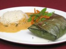 Pangasiusfilet auf Karotten-Ingwer-Bett im Bananenblatt mit Reis und Zuckerschoten - Rezept