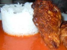 Hähnchenbrust in Kardamom-Parmesan-Hülle auf Tomatensauce und Reis - Rezept