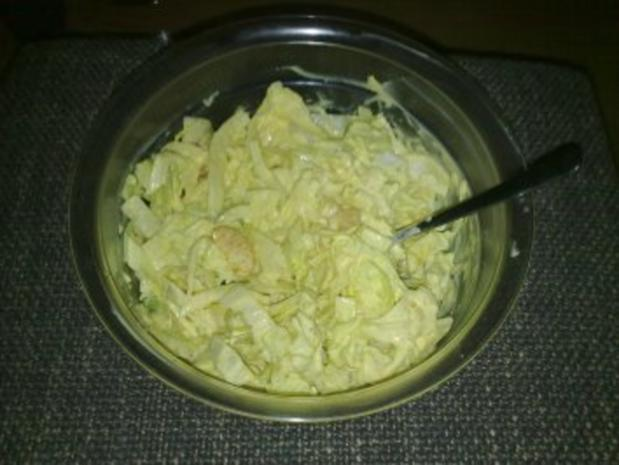 Eisbergsalat mit Curry-Dressing - Rezept