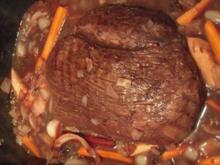 Hirschkeulenbraten mit Rotweinbirne - Rezept