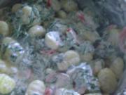 Gnocchi mit Tomaten-Rucola-Frischkäse-Sauce - Rezept