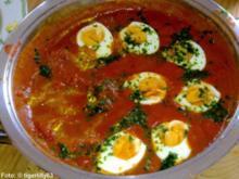 Eier in scharfer Tomatensauce - Rezept