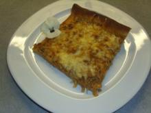Pizza mit Sauerkraut und Hackfleisch - Rezept