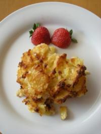 Kassler versteckt sich unter Röstis und Ananas - Rezept