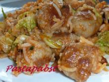 Bratwurstbällchen im Reisbett - Rezept