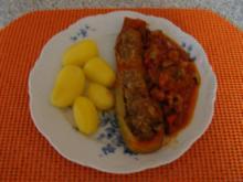 gefüllte Zucchini im Gemüsebeet - Rezept