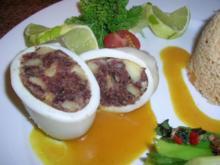 Calamari mit Blutwurstfülle,Tomaten-Couscous,Zwiebellauch-Zitronenmelisseragout - Rezept