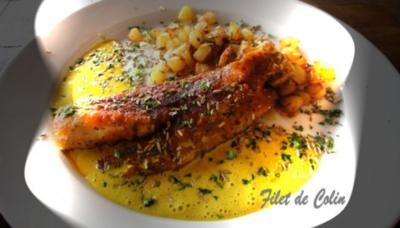 Filet de Colin auf Safran-Curry-Spiegel- Risoleekartoffeln in Gaenseschmalz und Kraeutern - Rezept