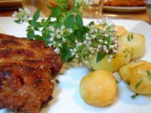 Scharfe Kalbsschnitzel mit Rosmarin-Knoblauch-Drillingen - Rezept