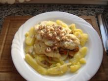 Dorsch mit Krabben und Schmorgurken-Pfifferlings-Gemüse - Rezept