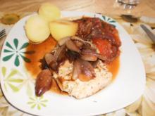 Italienische Koteletts mit Zwiebeln und Tomaten - Rezept