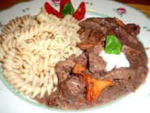 Rindsgeschnetzeltes mit Rotweinschalotten und Schwammerl - Rezept