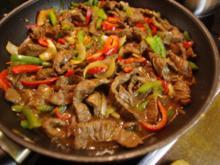 Rindfleisch mit Paprika und Zwiebeln - Rezept