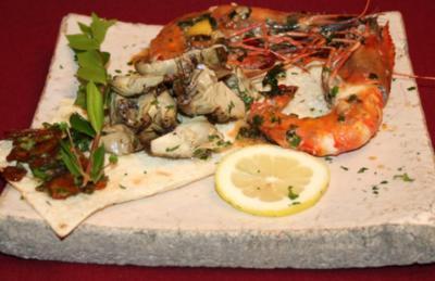 Fischrogen-Carpaccio, Oktopussalat und Scampi in Vernaccia-Soße - Rezept