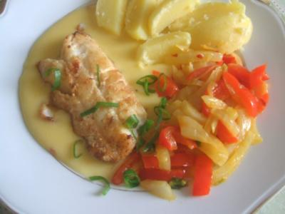 Kabeljau in Butter gebraten mit Kartoffelspalten  Orangen-Sahnesoße - Rezept