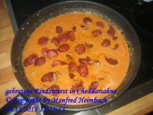 Wurst – gebratene Rindswurst in Cheddarsahne - Rezept
