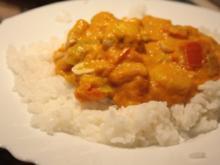 Geflügel, Huhn: Hähnchen-Kürbis-Curry mit Erdnüsse und Reis - Rezept