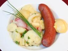 Gewärmte Rindswurst an lauwarmem Erdäpfelsalat - Rezept