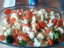 Tortellini im Gemüsebett mit Cremfrisch-Schmelzkäsesosse überbacken - Rezept
