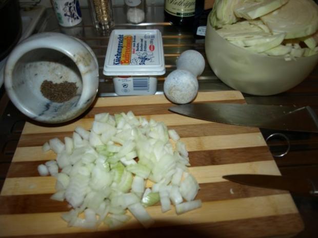 Kabeljau mit Räucherlachs gespickt auf gedünsteten Weißkohl - Rezept - Bild Nr. 2