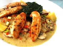 Hühnerbrust-Filets auf Champignon-Limone-Cognac-Sahne und Spinat - Rezept