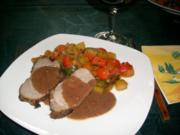 Lammbraten auf mediterranem Gemüsebett>> - Rezept