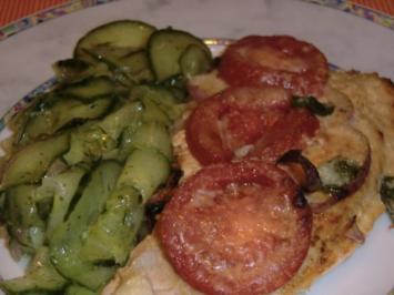 Gratinierte Putenschnitzel mit Tomaten - Rezept