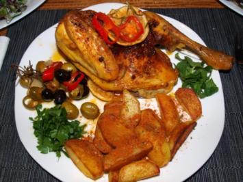 Halbe Maisbrathähnchen mit Oliven und Paprika - Rezept