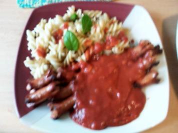 Rezept: Spirelli in Tomatensosse mit Würstchenigel
