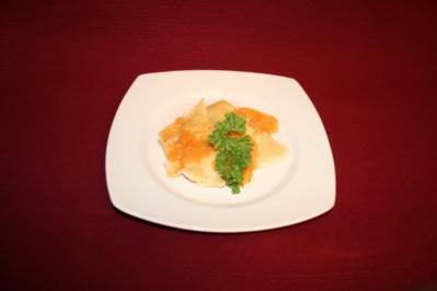 Garnelen-Chili-Ravioli mit Hummersoße - Rezept
