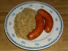 gedünstetes Sauerkraut mit Käsekrainer - Rezept