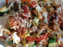 Fisch :  Resteauflauf mit Fischfilet eingebettet in Reis und Gemüse - Rezept