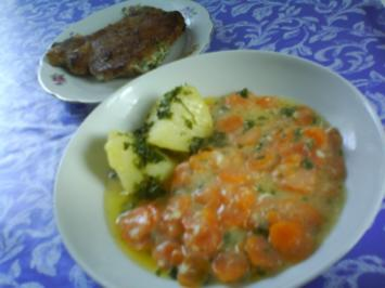 Kotelett's in knuspriger Nusspanade mit Kräuterkäsefüllung und Petersilienkartoffeln - Rezept