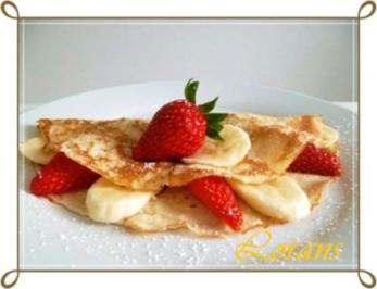 Crêpes mit Erdbeeren und Banane - Rezept