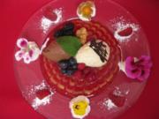Zweierlei Mousse au chocolat auf Früchtespiegel und gemischten Beeren - Rezept