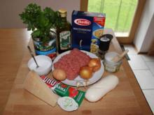 Hackbällchen mit Mozzarella-Kern in Tomatensoße und Makkaroni - Rezept