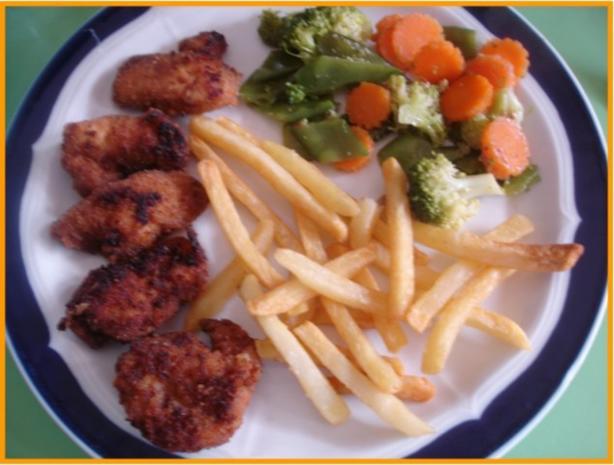 Hähnchennuggets mit Wokgemüse und Pommes frites - Rezept