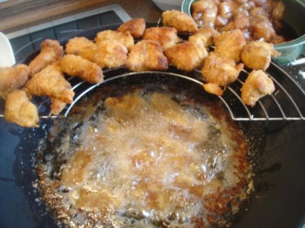 Hähnchennuggets mit Wokgemüse und Pommes frites - Rezept - Bild Nr. 10
