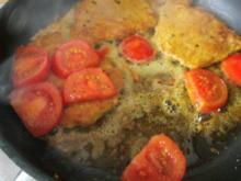 Kotelett mit gebratenen Tomaten und Spiegelei - Rezept