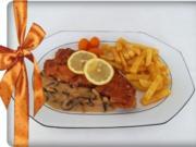 Knuspriges Schnitzel mit Pommes frites und Champignons-Rahmsauce - Rezept