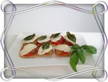 Toastbrot-Häppchen  mit Mozzarella und ….. überbacken - Rezept