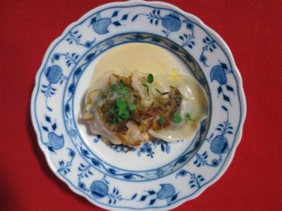Ravioli mit Boudin Noir auf Rahmsauerkraut, Echalotten und Majoran - Rezept