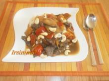 Rindfleisch mit Paprika, Zwiebeln und Cashewnüssen - Rezept