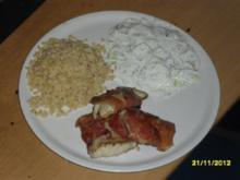 Seelachsfilet in Serano Schinken mit Ebly und Gurkensalat - Rezept