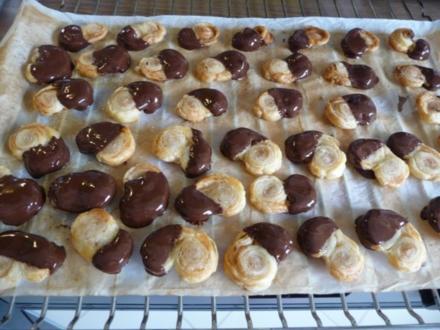 Plätzchen & Kekse : Kleine Schweineohren mit Schokolade - Rezept