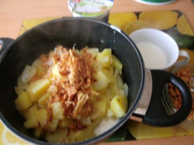 gebratener Fleischkäse mit Weinsauerkraut und Röstzwiebelstampfkartoffeln - Rezept - Bild Nr. 3