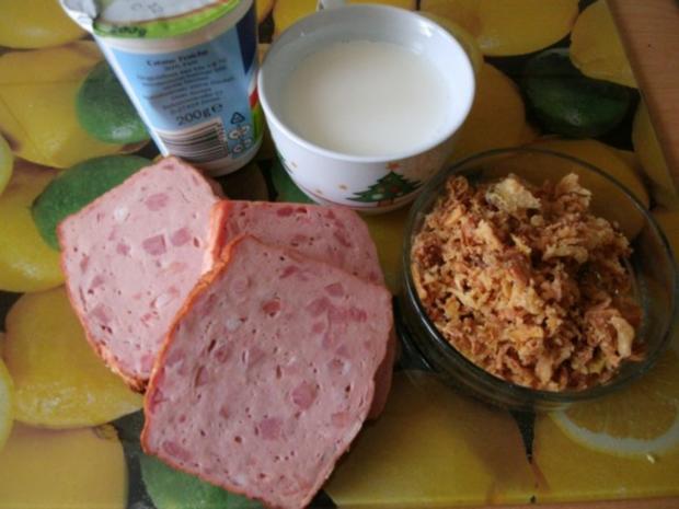 gebratener Fleischkäse mit Weinsauerkraut und Röstzwiebelstampfkartoffeln - Rezept - Bild Nr. 2