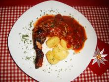 Hähnchenkeulen im Tomatenbett - Rezept