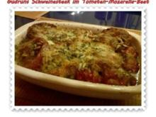 Fleisch: Pikantes Schweinesteak im Tomaten-Mozarella-Nest - Rezept