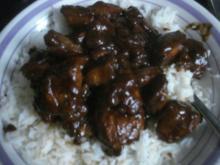 Hühnchen-Sate mit dunkler Erdnuss-Sauce und Basmatireis - Rezept